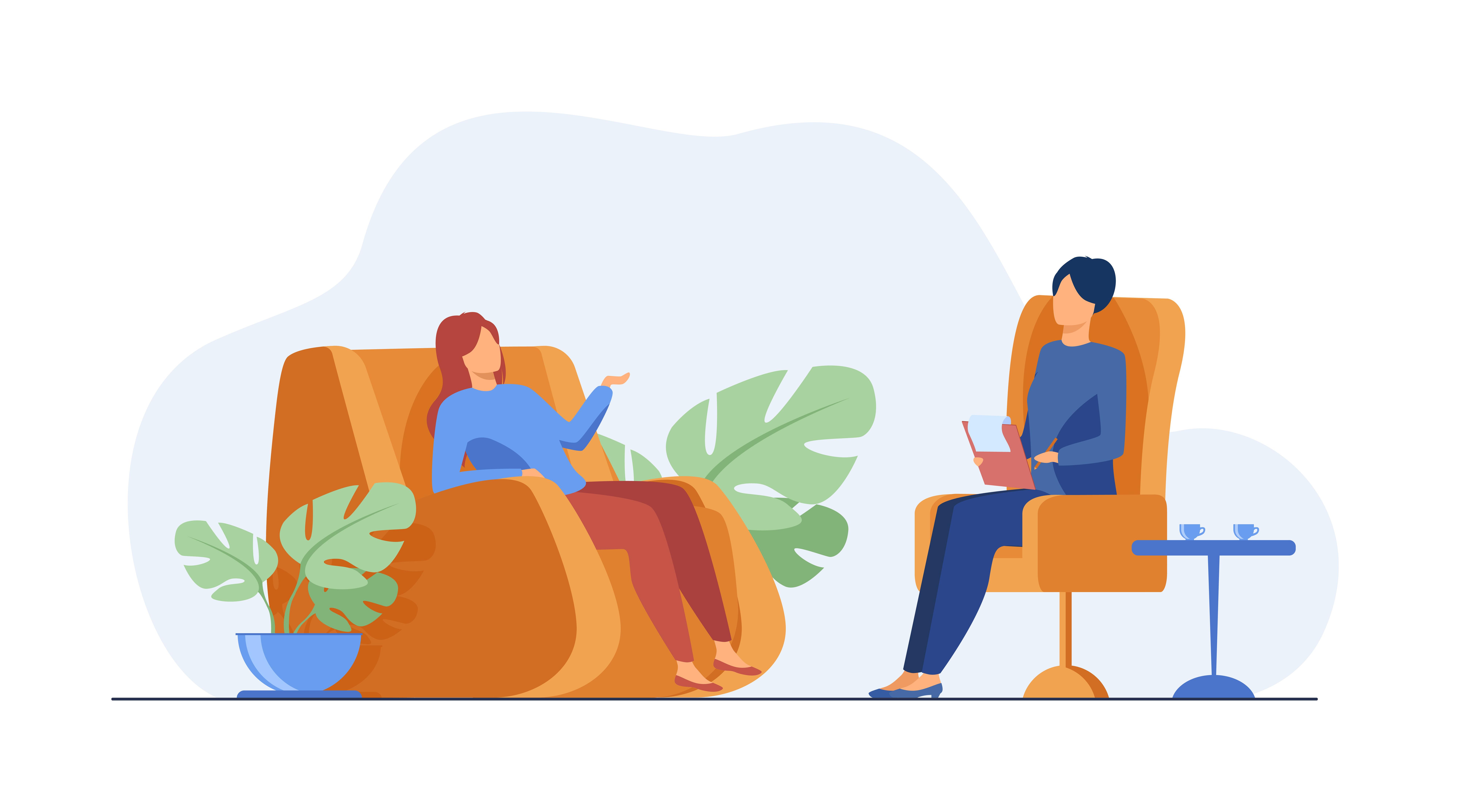 Duas mulheres sentadas uma de frente para a outra. A da esquerda é a paciente e a da direita a psicóloga. No ambiente estão visíveis apenas as poltronas, duas folhagens e uma mesinha com duas xícaras..